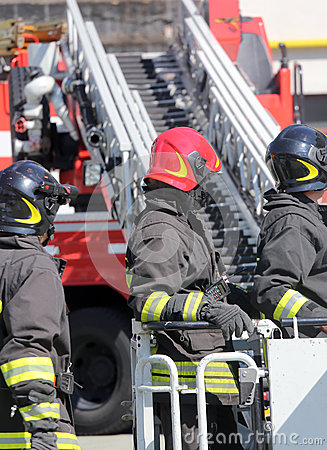 Free Firefighter In The Cage Of Fire Engine Stock Image - 54716111