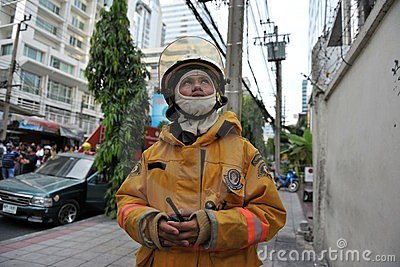 A Firefighter Looks on at Blaze in an Office Block Editorial Stock Image