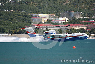 Firefighter seaplane Be-200 on rise from water Editorial Photo