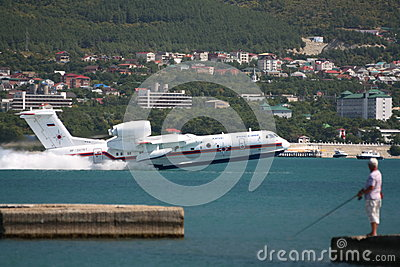 Firefighter seaplane Be-200ES in flight Editorial Photography