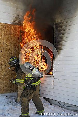Firefighter tackling blaze