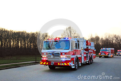 firefighter truck and emergency vehicles in street stock. Black Bedroom Furniture Sets. Home Design Ideas