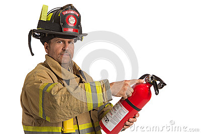 Firefighter in uniform holding fire extinguisher