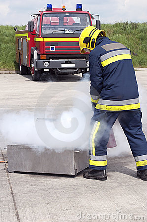 Firefighter using extinguisher
