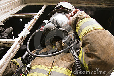 Firefighter at window