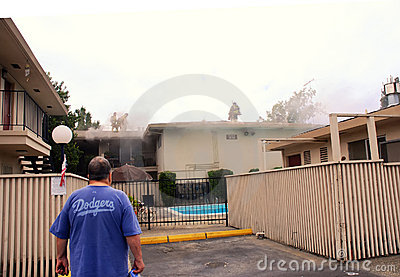 Firefighters Cutting Through My Roof Editorial Stock Image