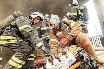 A firefighters extinguishes a burning restaurant Editorial Photography