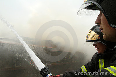 A firefighters extinguishes a burning restaurant Editorial Stock Photo