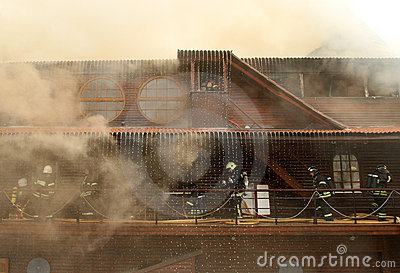 Firefighters extinguishing fire Editorial Photography