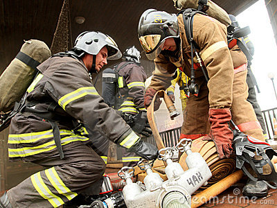 Firefighters extinguishing fire Editorial Stock Photo
