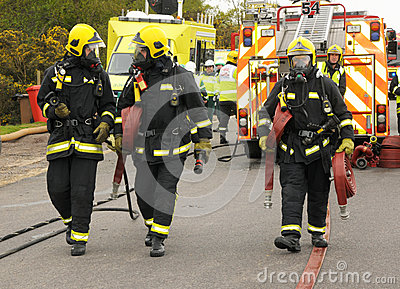 Firefighters and hoses Editorial Image
