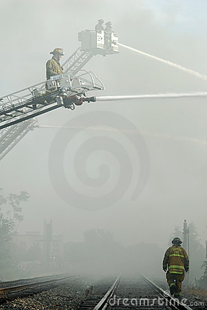 Firefighters and Railroad Tracks Editorial Photo