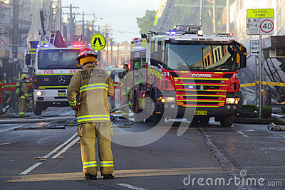 Firefighters and rescue crew attend shop blast