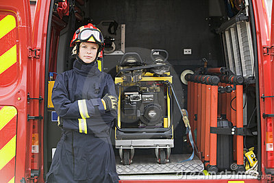 Firefighters standing by the equipment