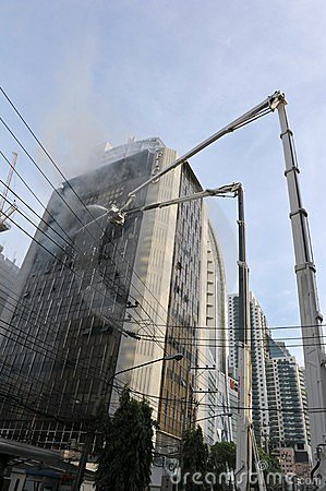 Firefighters Tackle a Blaze in an Office Block Editorial Stock Photo