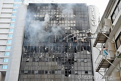 Firefighters Tackle a Blaze in an Office Block Editorial Stock Image