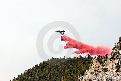 Firefighting aircraft dumping retardant