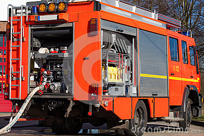 Firefighting vehicle with hose Stock Photo