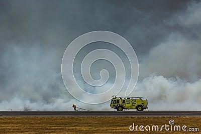 Fireman battles brush fire that closes San Salvador International Airport Editorial Photo