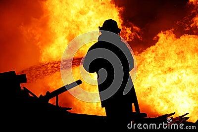Fireman controlling a huge fire