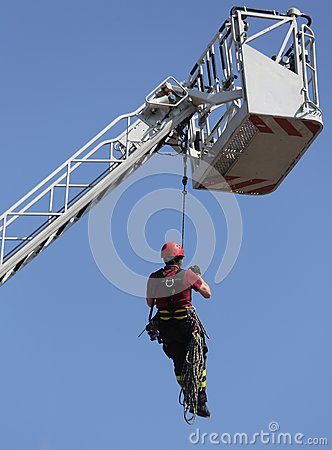 Free Fireman  Hung The Rope Climbing During Fire Drill Stock Photography - 55757382