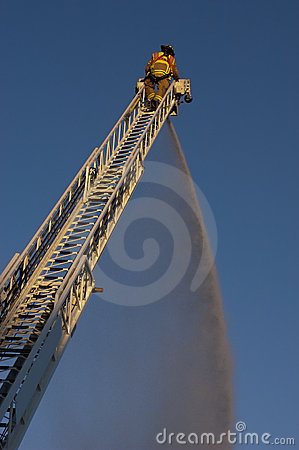 Fireman on Ladder Truck Spray Water on Fire