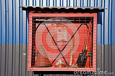 Fireman tols box on farm wall