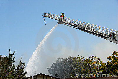 Fireman Using Water Cannon From Ladder