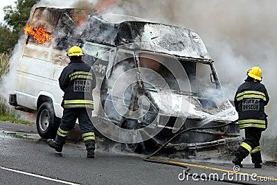 Firemen and Burning Motor Car