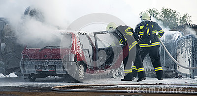 Firemen at car fire