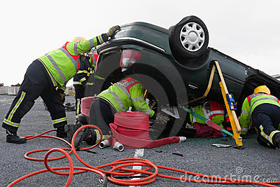 Firemen with equipment at car crash Editorial Photo