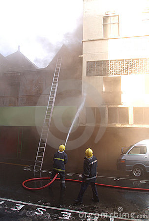 Firemen fighting fire in Port Louis Editorial Stock Photo