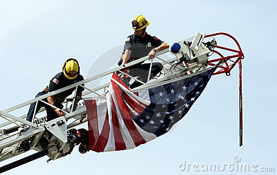 Firemen hanging US flag