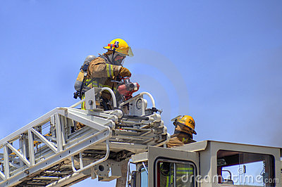 Firemen on a ladder truck