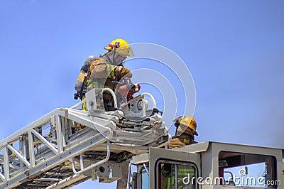 Firemen on a ladder truck