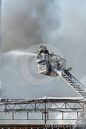 Firemen on a lift