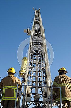 Firemen raise a ladder