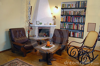 Fireplace with two armchairs