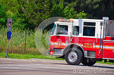 Firetruck driving fast with flashing lights Editorial Stock Photo