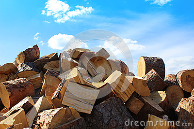 Firewood pile and blue sky