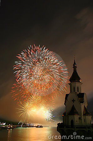 Firework and church on river