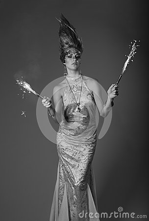 Firework holding woman in eveningdress with upright hair