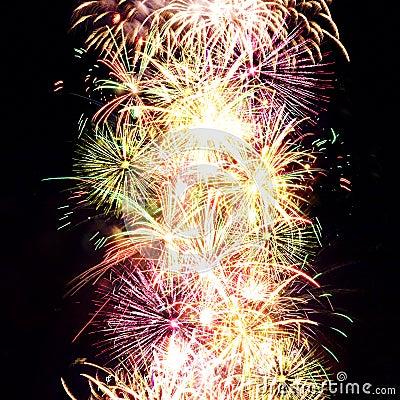 Firework streaks in night sky, celebration