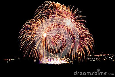 Firework streaks in night sky, celebration