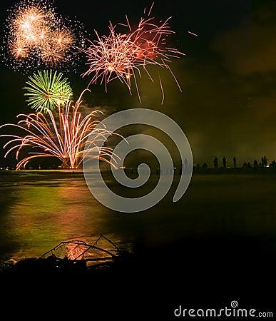 Fireworks display over sea