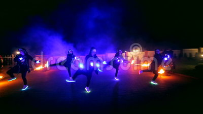 Fireworks. Fire show. Boys and girls dance in shoes that glow in the night.  stock video