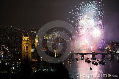Fireworks over London Eye and Westminster Editorial Stock Photo