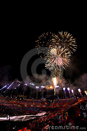 Fireworks over stadium during ending with crowd Editorial Stock Image