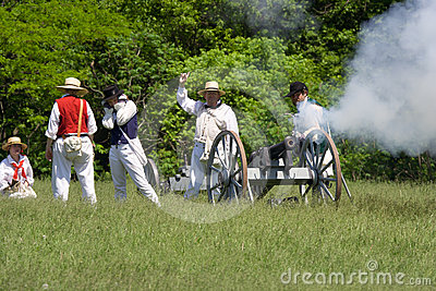 Firing a cannon at a War of 1812 re-enactment Editorial Stock Image