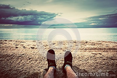 First person perspective of man legs on the beach. Vintage